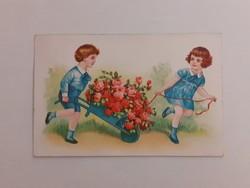 Régi képeslap 1942 gyerekek egy talicska rózsával levelezőlap