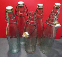 Retro csatos porcelánfejes üdítős üvegek, 6 db-os gyűjtemény eladó.