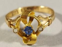 18 karátos arany gyűrű 16,2 mm átmérővel, zafír kővel