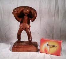 Faragot szobor, férfi zsákkal