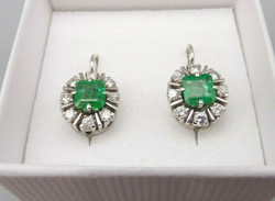 White gold earrings with emerald and diamond stones 0.65 Ct
