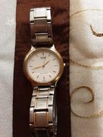 Férfi Casio quartz karóra, arany ezüst fémszíjjal, működik