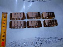6 db rozsdamentes   szalvéta gyűrű-áttört díszítéssel -kés, villa, kanál motívummal 300 FT/ db