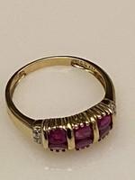 Eladó sárga arany 9 kt. női gyűrű, egyedi berakásos gyönyörű rubin kövekkel.