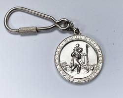 Szent Kristóf ezüstözött kulcstartó.