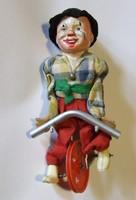 Ritka régi, retró játék: celluloid fejű bicikliző bohóc figura eredeti állapotában