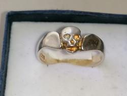 Ezüst gyűrű kopnyonya díszítéssel 925
