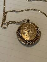 Nagyon régi 14 kr aranyból készült medallion szép lánccal eladó!Ara:98000.-