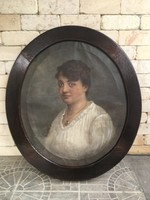 Női portré ovál keretben
