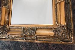 Impozáns aranyozott tükör