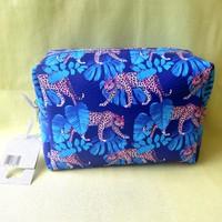 Párduc mintás kék, lila táska, neszeszer