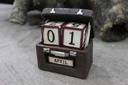 Brown suitcase perpetual calendar