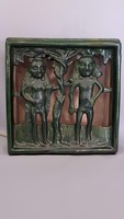Old scratched ceramic lamp of Adam and Eve