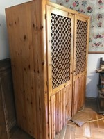 Wooden cabinet with clothes