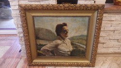 Female portrait in beautiful frame with old oil painting
