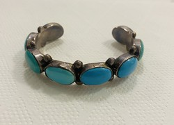 Beautiful silver bracelet for sale decorated with turquoise stone!