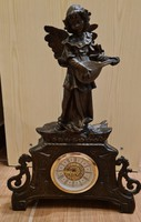 Antique spy angelic fireplace decoration, statue, clock