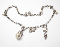 Silver anklet with charms.