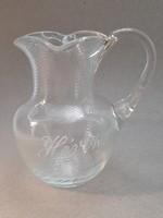 Old torn glass jug with the inscription Hévíz