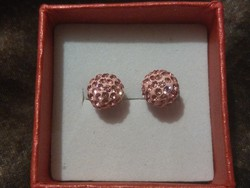 Gold earrings with sparkling stones