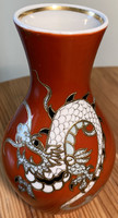 About one forint - Wallendorf dragon vase burgundy on a white background
