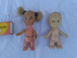 Two pieces of old toy dolls together - transport goods