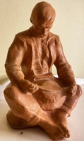 About one forint - a terracotta statue of a younger black gauze