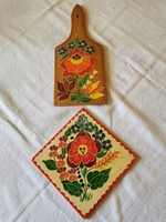 Hand painted tiles, mural, dish washer and wall cutting board together