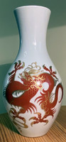 About one forint - Wallendorf dragon vase on a burgundy white background
