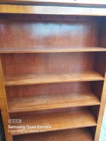 Biedermeier style bookcase up to a couple