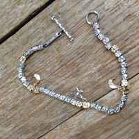 Silver bracelet with 3 pieces of brilliant stones