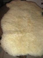 Beautiful sheep small rug with long dense wool