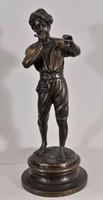 Young flutist boy with antique sculpture