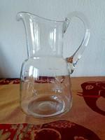 Old blown polished glass jug