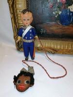 Old figure - slightly morbid - with black head on rope