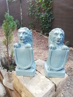 Shielded lion statue couple-outdoors-indoors