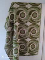 A pair of retro patterned greenish blinds