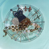 Beautiful crystal jewelry in cut glass bowl offering centerpiece
