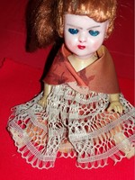 Antique celluloid hairy glass-eyed implantable doll as shown