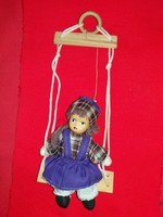Old small porcelain rocking doll in beautiful condition as shown