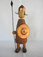 Wooden knight soldier holding spear and shield