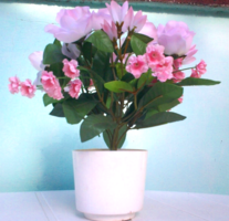 Beautiful potted silk flower decorated with roses