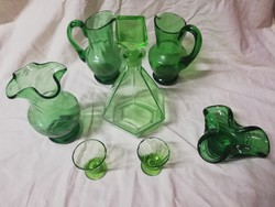 Uranium green, emerald green jugs with liqueur glass in the middle of the table and everything in the pictures.