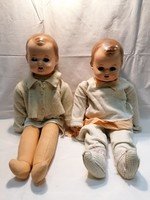 Baby pair of old glass-eyed hangers