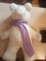 Craft teddy bear in purple scarf and hat
