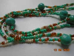 Long necklace of green, white, gold-colored small beads, green with larger beads