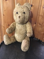 Old retro plush teddy bear with straw stuffing 40 cm