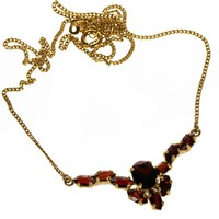 Gold collier with garnet stones