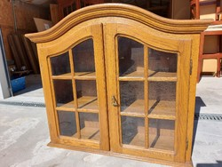 For sale an oak wall showcase dimensions: 95 cm x 29 cm x 84 cm high. I can get a discount on shipping