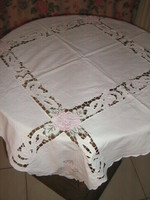 Beautiful elegant embroidered risotto with lace stitched tablecloth